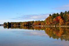 Fall Tree Reflections Lake Sabago Maine. Autumn fall trees reflect colors on Lake Sabago, Maine, USA Royalty Free Stock Images