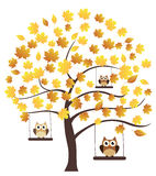 Fall Tree. Vector fall tree with leaves and owls swinging Royalty Free Stock Images