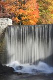 Fall trees and waterfall Stock Images
