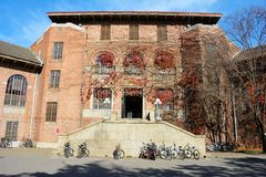 Fall university campus. Part of library covered with red ivy leaves in Tsinghua university campus in fall royalty free stock image
