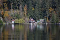 Fall Vacation. Cabins along the shoreline of a lake in the fall Stock Image