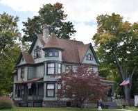Fall Victorian. This is a Fall picture of a large 20th Century Victorian home located in Dowagiac, Michigan in Cass County. This wooden Queen Anne house features stock photo