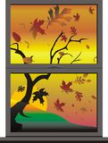 Fall View Through a Window. At sunset with wind and leaves blowing Royalty Free Stock Image