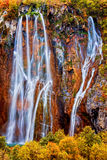 Fall Waterfall. Majestic waterfall in scenic autumn landscape of Plitvice Lakes National Park in Croatia, high saturation HDR technique Royalty Free Stock Photography
