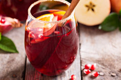 Fall and winter sangria. With apples, oranges, pomegranate and cinnamon royalty free stock images