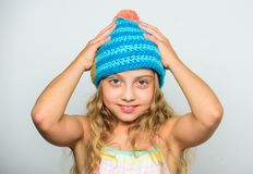 Fall winter season accessory. Knitted hat with pompon. Girl long hair happy face white background. Difference between. Knitting and crochet. Kid wear warm soft royalty free stock image