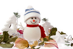 Fall and Winter snowman. On white background with Christmas decorations and dry rose petals stock image