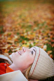 Fall woman. Young woman lying down in the fall leaves Stock Photo