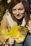 Fall woman holding autumn leaves Stock Photos