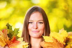 Fall. woman holding autumnal leaves in park Royalty Free Stock Photos