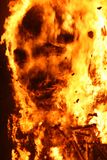 Falla burning sculpture with human face look alike of ninot burn. Valencia Falla Ninot fierce burning with face look alike at end of festivities stock photography