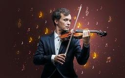 Fallande anmärkningar med den klassiska musikern royaltyfria foton
