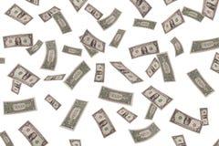 Fallande dollar på vit bakgrund Royaltyfri Fotografi