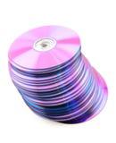 fallande högpurple för cds Arkivbilder