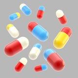 fallande isolerade medicinska pills Royaltyfri Foto