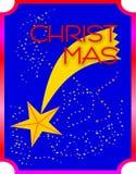 Fallande julstjärna på blå himmel, med små stjärnor royaltyfri foto