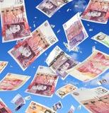 fallande pengar Arkivfoto