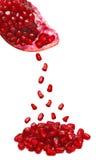 fallande pomegranatefrö Arkivfoto