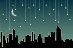 fallande stjärnor för cityscape Arkivbild