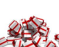 Fallande vita gåvaaskar med det röda bandet Royaltyfri Fotografi