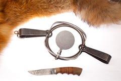 Falle und ein Messer Stockbild