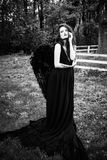 Fallen angel with black wings Stock Images