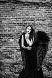 Fallen angel with black wings Royalty Free Stock Images