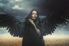Fallen angel in a desert landscape Stock Photos