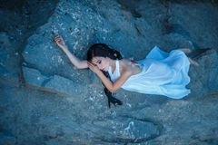 A girl with torn off wings Stock Photography