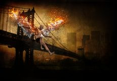 Fallen angel. Surrealism. Manhattan bridge. Naked man with burning wings symbolizes fallen angel. Human elements were created with 3D software and are not from vector illustration