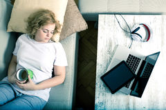 Fallen asleep in the living room besides a Tablet PC and a Lapto Royalty Free Stock Images