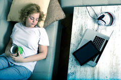 Fallen asleep in the living room besides a Tablet PC and a Lapto Royalty Free Stock Image