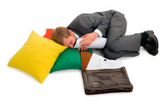 The fallen asleep man the businessman. The man the businessman fallen asleep behind work, has dreams about work Stock Photo