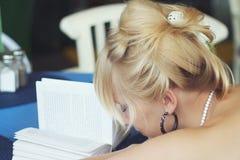 Fallen asleep over a book Stock Images