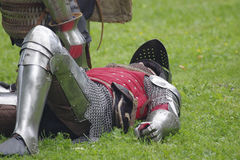 Fallen in battle, a knight dressed in armor. Saint Petersburg, Russia - July 13, 2017: III Historical and Cultural Festival `For Russia and Russian piety Stock Photo