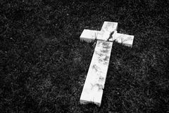 Fallen and broken down marble cross Royalty Free Stock Photography