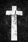 Fallen and broken down marble cross Stock Photos