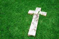 Fallen and broken down marble cross Royalty Free Stock Photo