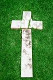 Fallen and broken down marble cross Stock Image