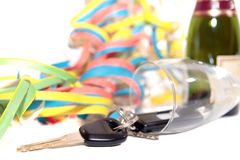 Fallen champagne flute and car keys Royalty Free Stock Photography