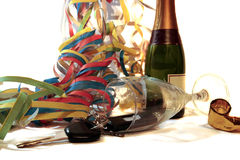 Fallen champagne glass and car keys Stock Photo