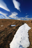 Fallen cloud. Snowdrift with signs on top of a mountain Stock Photography