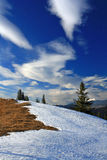 Fallen cloud. Snowdrift with signs on top of the mountain against the blue sky Royalty Free Stock Photography