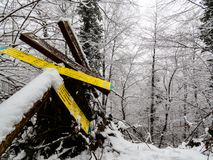 Fallen direction signs in winter royalty free stock photography
