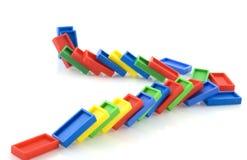 fallen domino samlar Arkivfoto