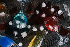 Fallen drinking glasses Stock Images