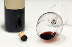 Fallen almost empty red wine cup Royalty Free Stock Photography