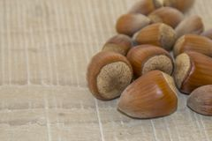Hazelnuts on a wooden base Royalty Free Stock Photography