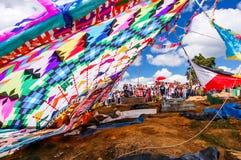 Fallen giant kite, All Saints' Day, Guatemala. Santiago Sacatepequez, Guatemala - November 1, 2010: Fallen giant kite among graves. Locals display huge circular Royalty Free Stock Images