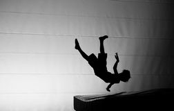 Fallen gymnast silhouette on trampoline Royalty Free Stock Photography